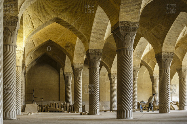 Shiraz, Iran - February 16, 2015: A worker in the Vakil Mosque which is constantly under repair, with the majority of visitors now tourists admiring the stunning stone work