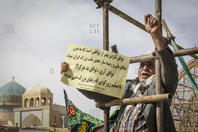 Yazd, Iran - February 11, 2015: Man protesting during the 'Ten Days of Dawn' protests
