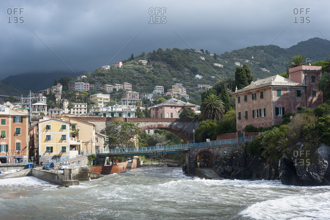 The sea swirls into a hilly, oceanfront village on the Italian Riviera