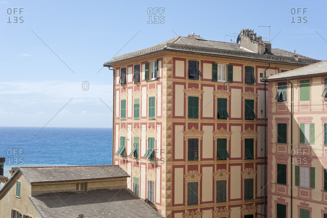 Building on hillside above the sea in the Northern Italy