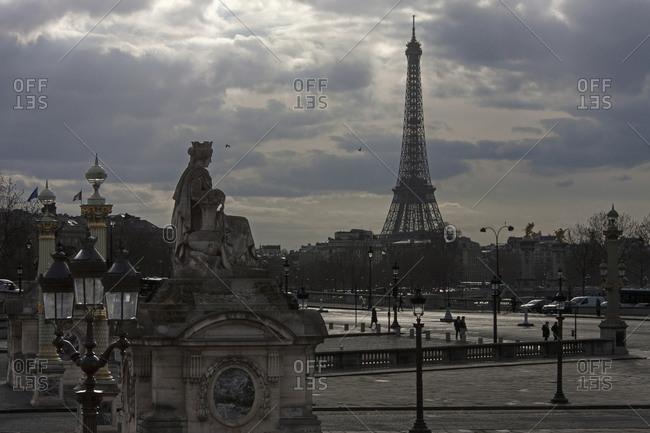 Eiffel Tower against cloudy sky, Paris