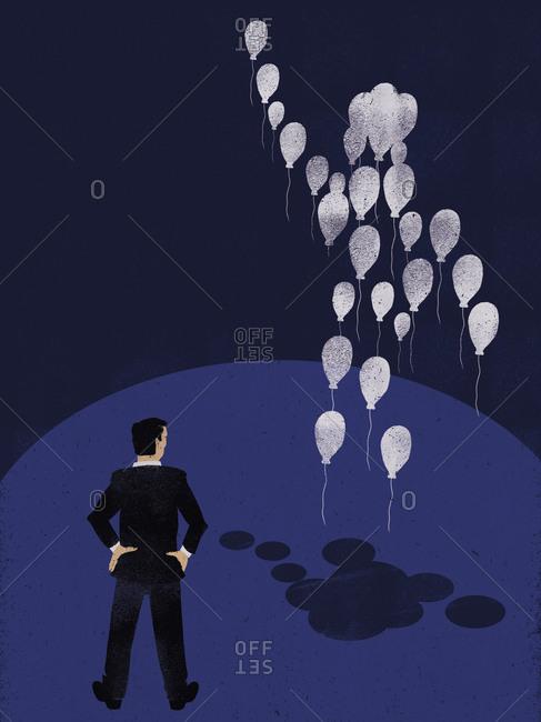 Man watching a balloon body
