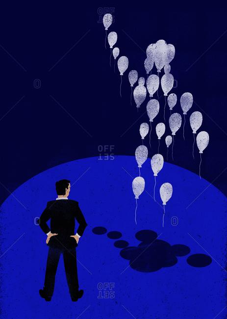 Man watching balloon body