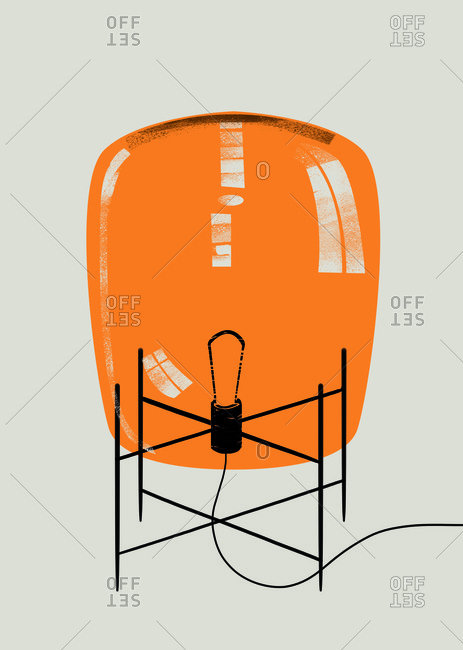 Light bulb on stand with orange cover