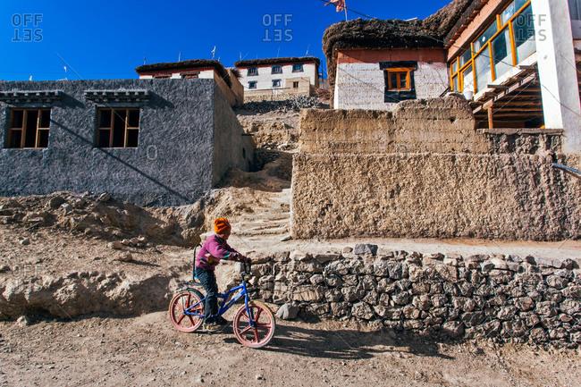 Kid on bicycle in Indian Himalayas village