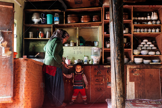Woman and girl making tea in India Himalayas home