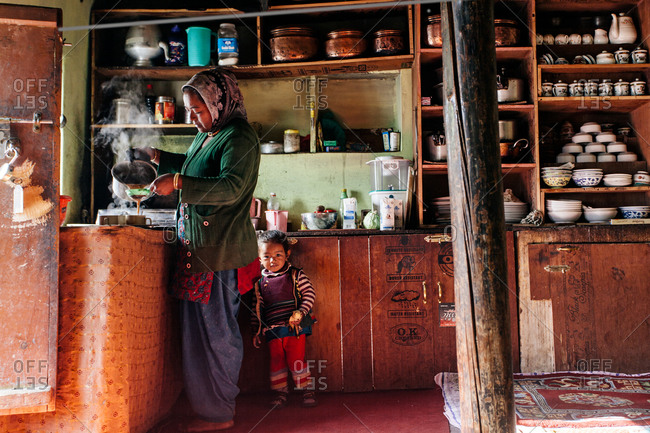 Woman and girl making tea in India Himalayas house