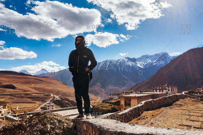 Man overlooking Kibber village in the Indian Himalayas