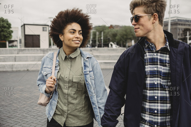 Young couple walking in Bristol, UK