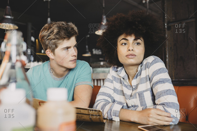 Man looking at his girlfriend in a restaurant
