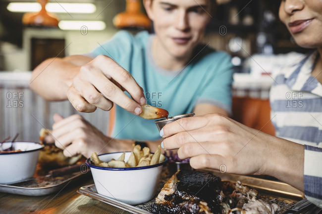 Couple eating fries in a restaurant
