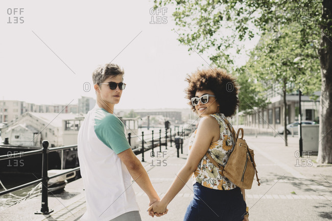 Young couple walking on the promenade in Bristol, UK