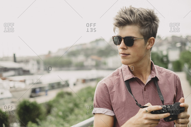 Young man holding a camera in Bristol, UK