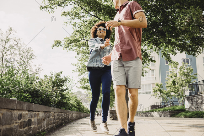 Young couple walking together in Bristol, UK
