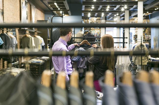New York City - June 2, 2015: Stylist helping a man shop