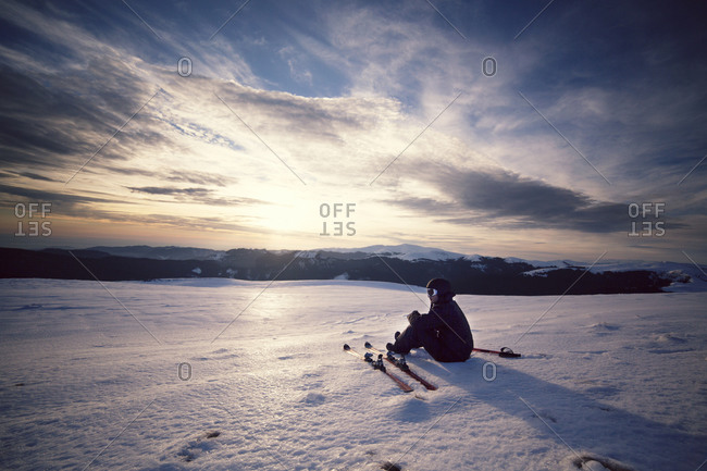 Skier resting at the snowy Carpathian Mountains