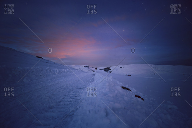 Road signs at the snowy Carpathian Mountains at night