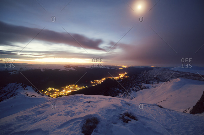 City lights at the snowy Carpathian Mountains