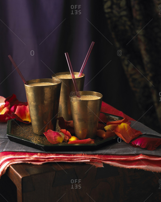 Cold, frothy Indian drinks in copper cups