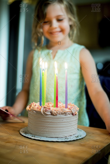 Girl blowing out birthday candles on cake