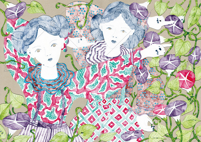 Two women in patterned dresses standing in morning glory vines