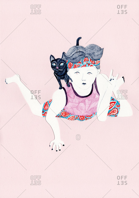 Boy in headband and paisley shorts with cat on his back makes a hand gesture