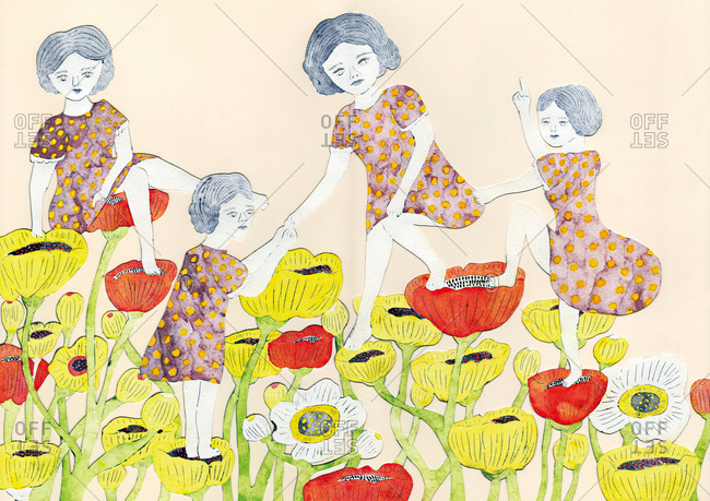 Four girls in matching dresses standing on poppy flowers