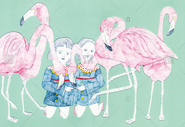 Two kneeling girls in identical dresses surrounded by flamingos touch fingertips