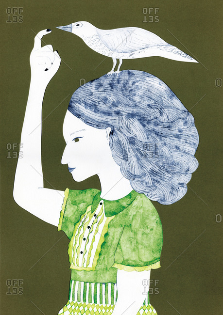 Woman pointing at a white bird on her head