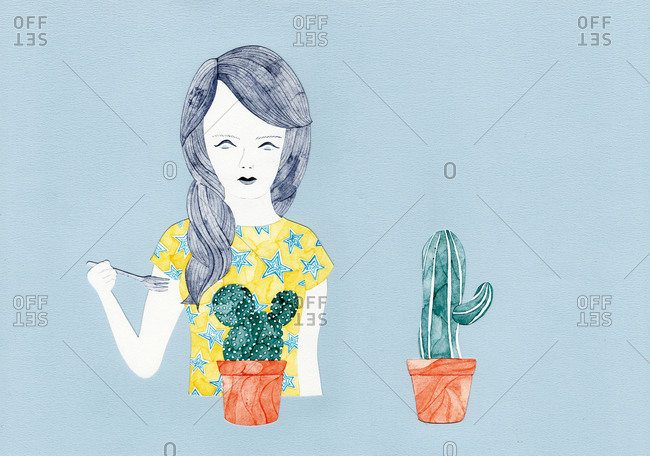 Woman with fork seated before two cactus plants