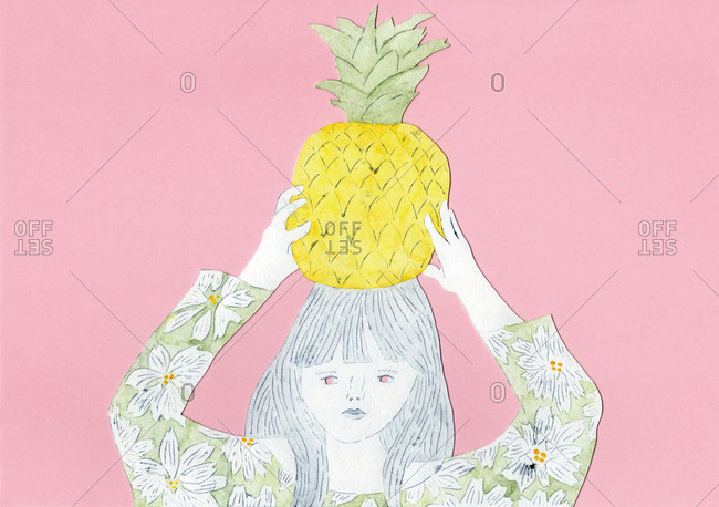 Woman holding a pineapple on her head