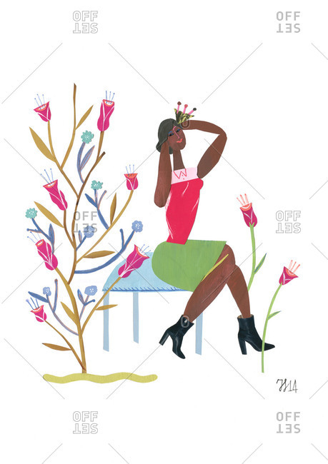 Woman sitting seductively by flowers