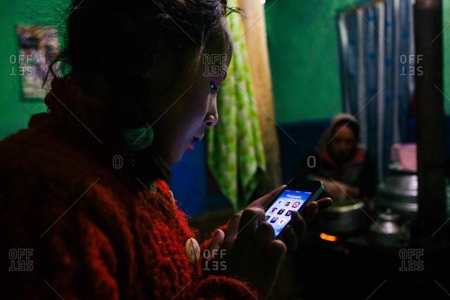 Himachal Pradesh, India - October 19, 2013: Girl in Langza village using a smartphone in Himachal Pradesh, India