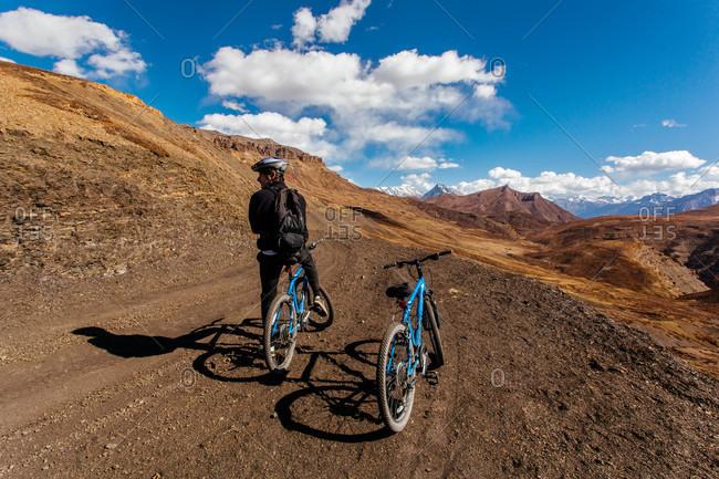 Himachal Pradesh, India - October 19, 2013: Man mountain biking in Himachal Pradesh, India