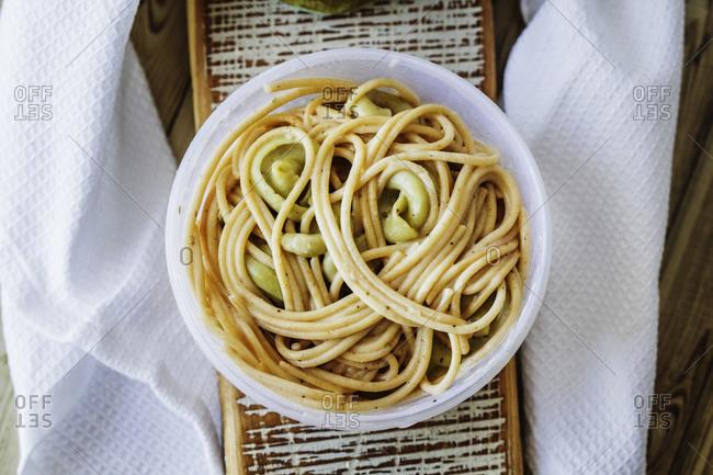 A bowl of spaghetti and tortellini