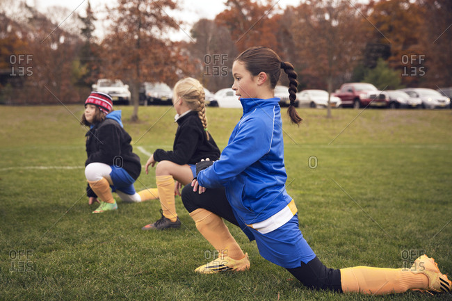 Girls stretching for soccer