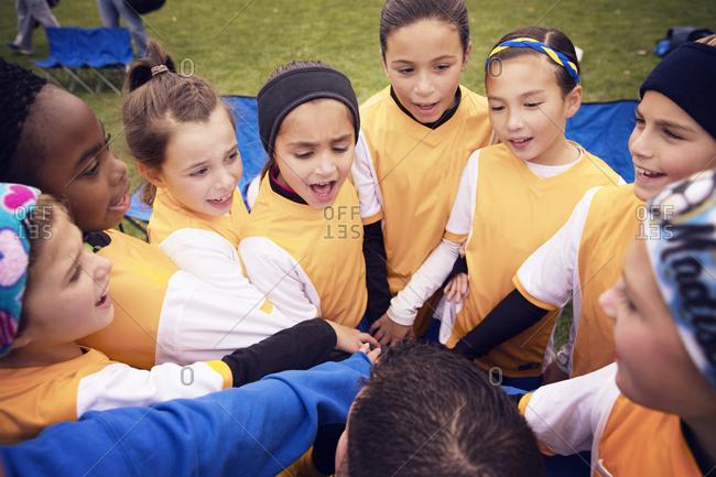 Girls huddling up before soccer