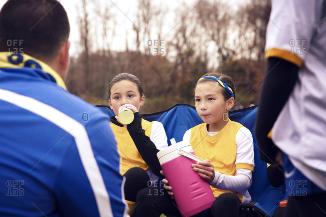 Soccer coach talking to girls