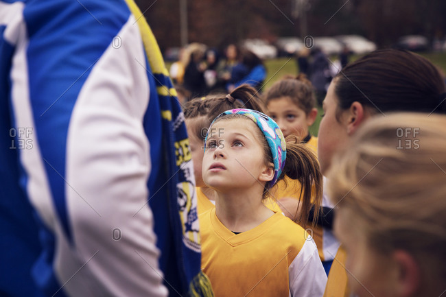 Girl listening to coach during soccer game