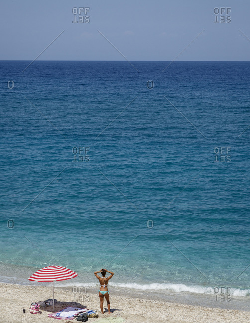 Woman at Agioi Saranta beach, Pelion peninsula, Greece