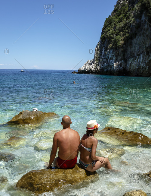 Couple relaxing at Fakistra beach, Pelion peninsula, Greece
