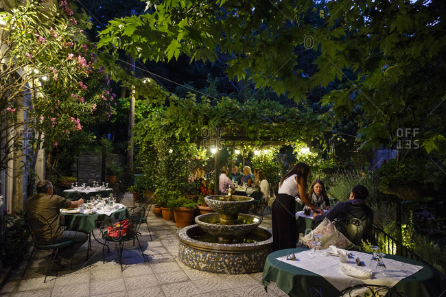 Tsagarada, Greece - July 11, 2014: People dining al fresco at a restaurant