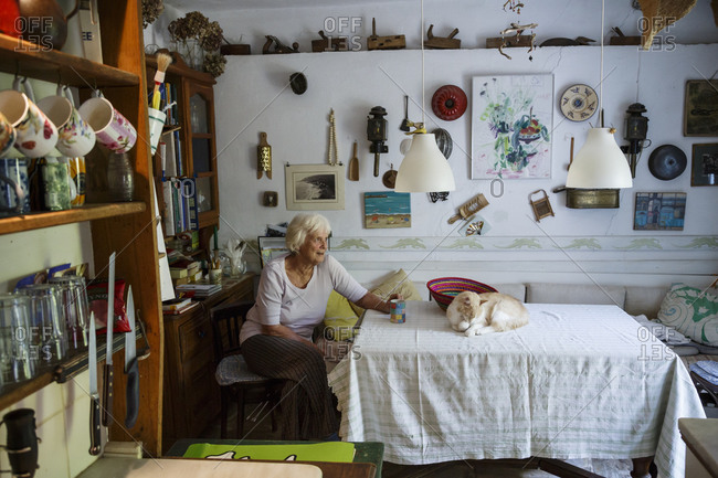 Tsagarada, Greece - July 17, 2014: Elderly woman with a cat