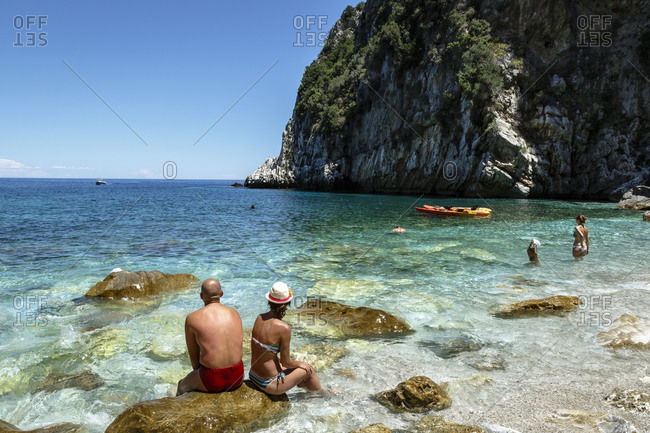 People relaxing on Fakistra beach, Pelion peninsula, Greece