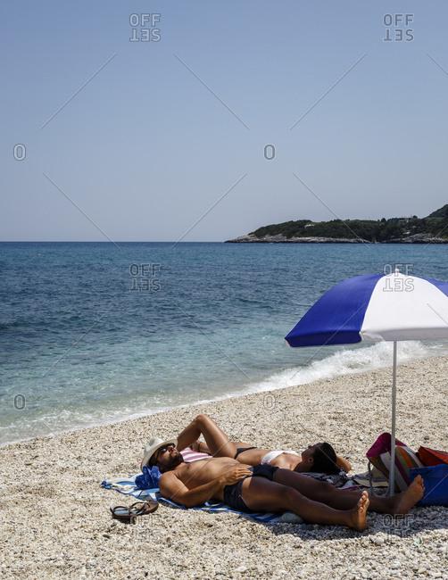 Chorefto, Greece - July 17, 2014: Couple at Papa Nero beach