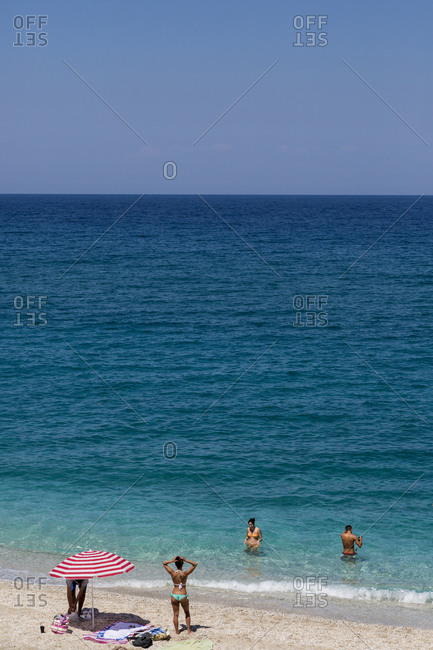 Chorefto, Greece - July 17, 2014: People at Agioi Saranta beach