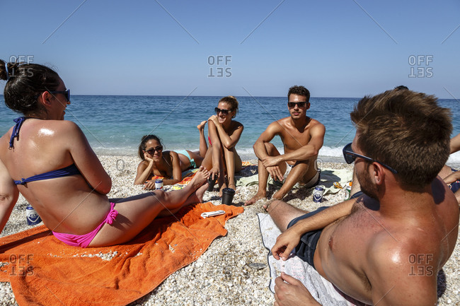 Chorefto, Greece - July 17, 2014: Young people hanging out at Agioi Saranta beach