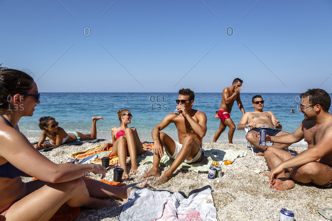 Chorefto, Greece - July 17, 2014: Friends at Agioi Saranta beach
