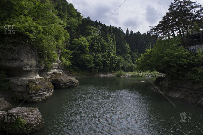 Bend in river with tourists viewing scenery of Tonohetsuri Ravine, Shimogo, Japan