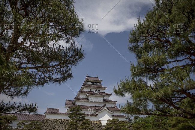 White Aizuwakamatsu Castle on hill in Japan